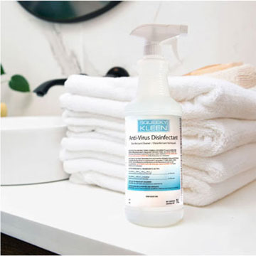 Dayjan Enterprises Squeeky Kleen Anti-Virus Disinfectant Spray Bottle in front of folded towels